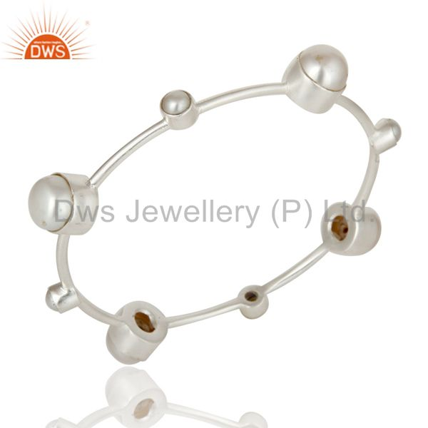 Supplier of Silver plated over brass and pearl sleek bangle bracelet
