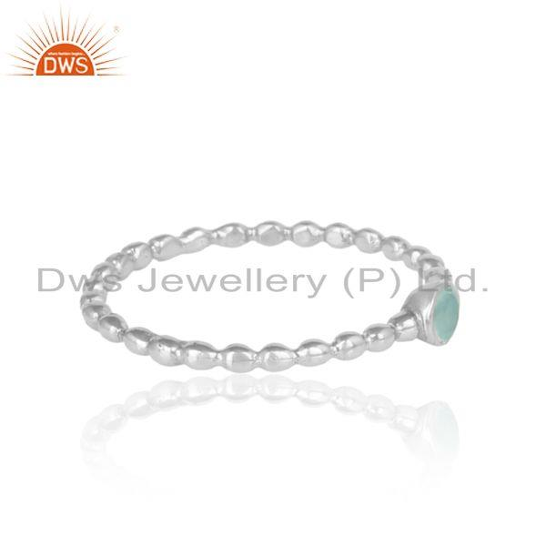 Textured aqua chacedony solitaire ring in rhodium on silver 925