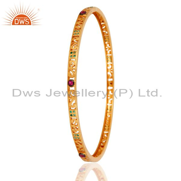 Supplier of 18k yellow gold over green red cubic zirconia designer sleek bangle