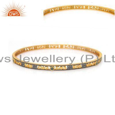 Supplier of 18k yellow gold on 925 silver green cubic zirconia fashion bangle
