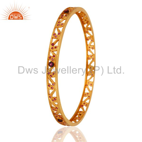 Supplier of 18k yellow gold over red cubic zirconia anniversary fashion bangle