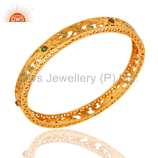 Supplier of 14k yellow gold plated filigree bangle with green cubic zirconia