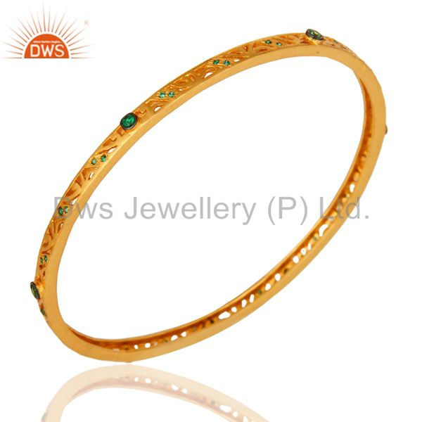 Supplier of 14k yellow gold plated brass green cubic zirconia sleek bangle