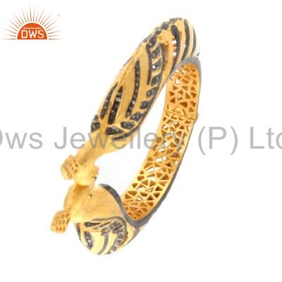 Supplier of 18k yellow gold over 925 silver pave set diamond peacock bangle