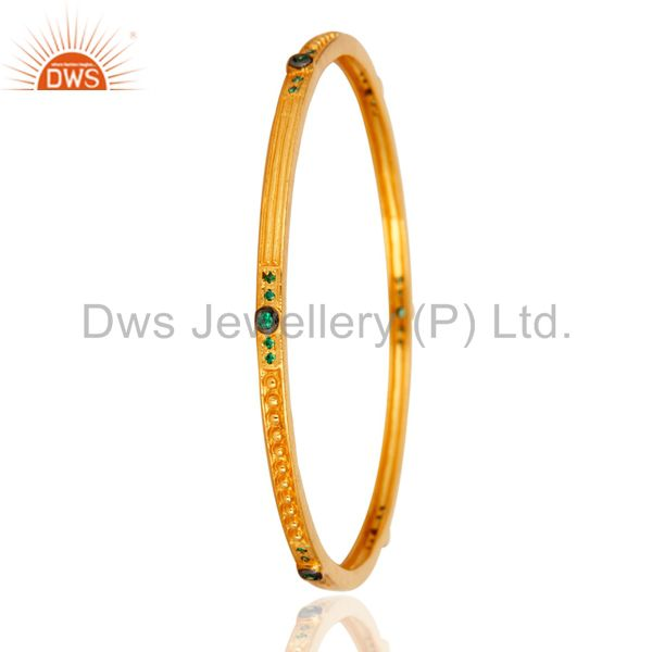 Supplier of 18k yellow gold over emerald cubic zirconia wedding fashion bangle