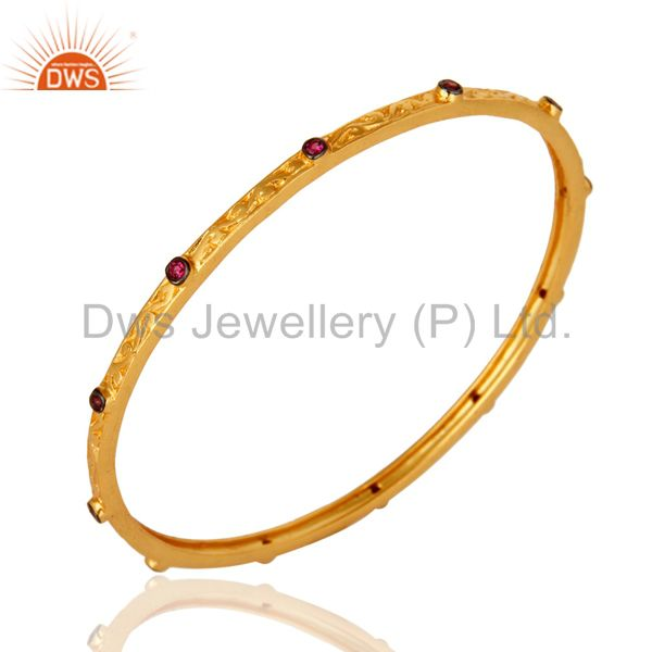Supplier of Ruby cubic zirconia 22k yellow gold plated brass designer bangle