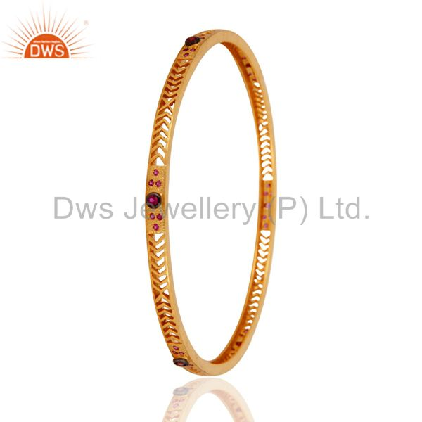 Supplier of Handmade fashion created ruby 14k yellow gold plated sleek bangle