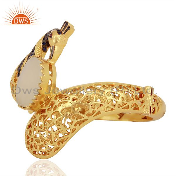 Supplier of 14k yellow gold on peach moonstone blue cz peacock bangle jewelry