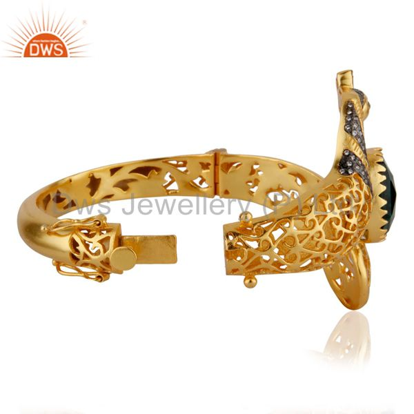 Supplier of 18k gold on unique peacock design openable bangle green glass cz