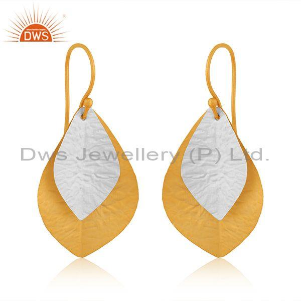 Handmade and hand hammered white and gold on silver earrings
