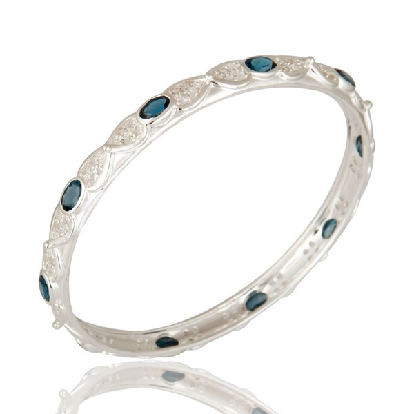 Supplier of London blue topaz gemstone sterling silver bangle with white topaz