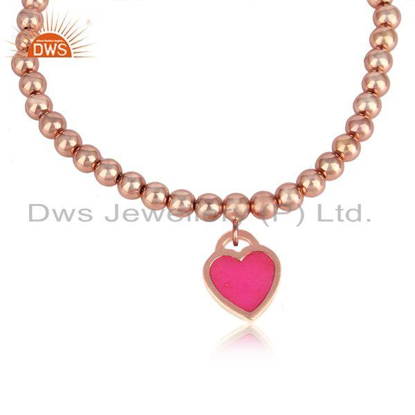 Rose gold on silver bead bracelet with pink enamel heart charm