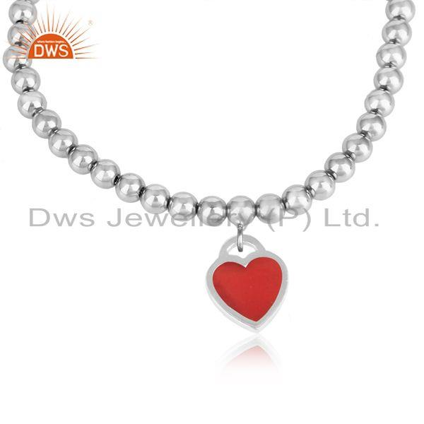 Rhodium plated silver bead bracelet with red enamel heart charm