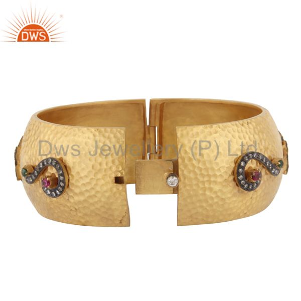 Supplier of Matte finish 18kt gold plated hand hammered cubic zirconia bangle