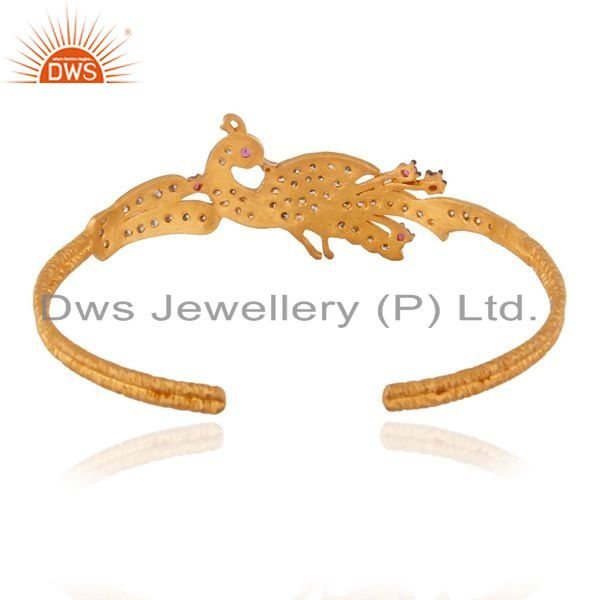 Supplier of 18k yellow gold on sterling silver red cubic zirconia peacock cuff