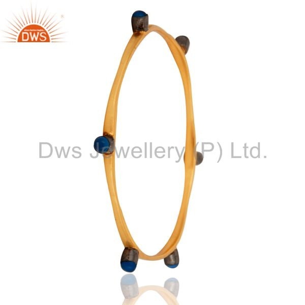 Supplier of 18-carat yellow gold plated blue chalcedony gemstone womens bangle
