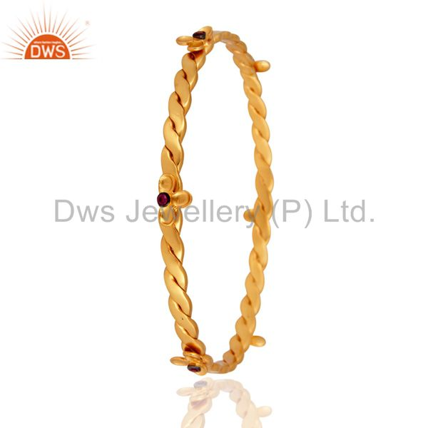 Supplier of 18k yellow gold plated red cubic zirconia handmade bangle
