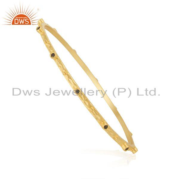 Supplier of 18k gold on 925 silver sapphire blue cubic zirconia fashion bangle