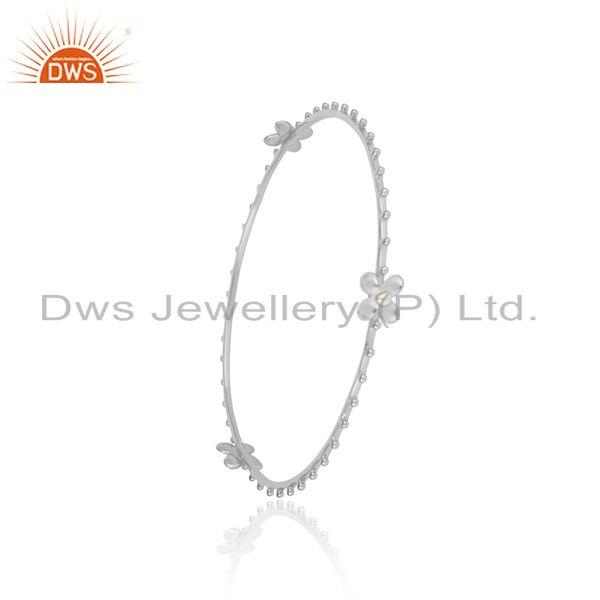 Designer floral bangle made of solid silver with white pearl