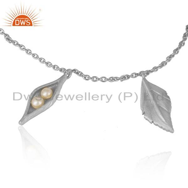 Designer seedpod charm bracelet in solid silver with natural pearl