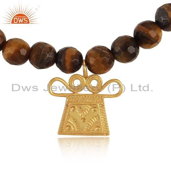 Tiger eye bead bracelet with designer charm in yellow gold on silver