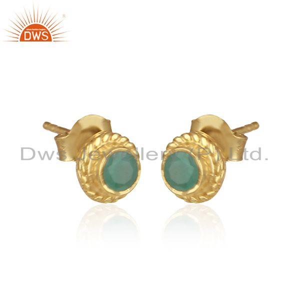 Handmade textured earring in yellow gold on silver with emerald