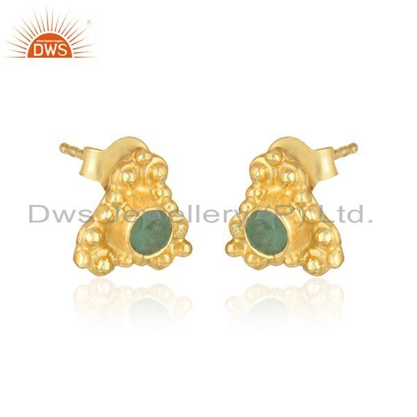 Handmade designer earring in yellow gold on silver with emerald