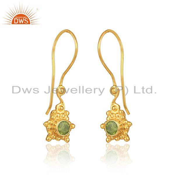 Designer dangle earring in yellow gold on silver with peridot