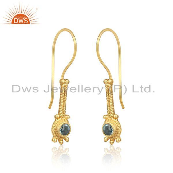 Designer long earring in yellow gold on silver with blue topaz