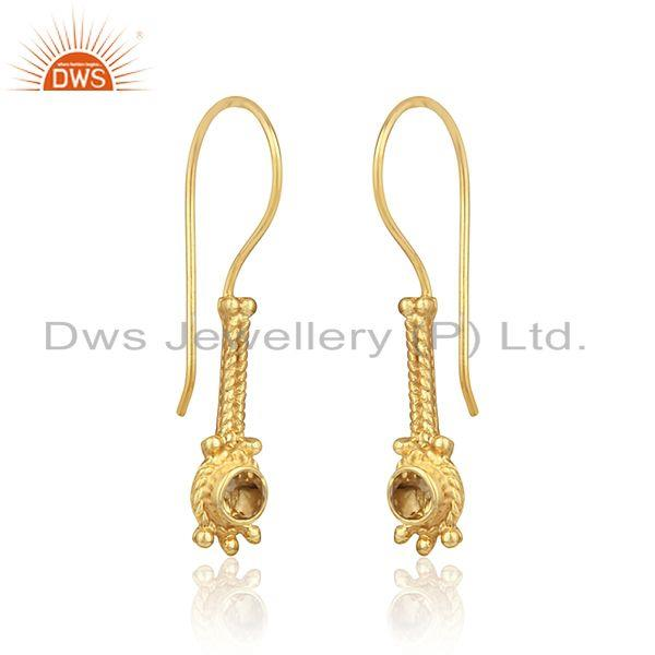 Elongated design earring in yellow gold on silver with citrine