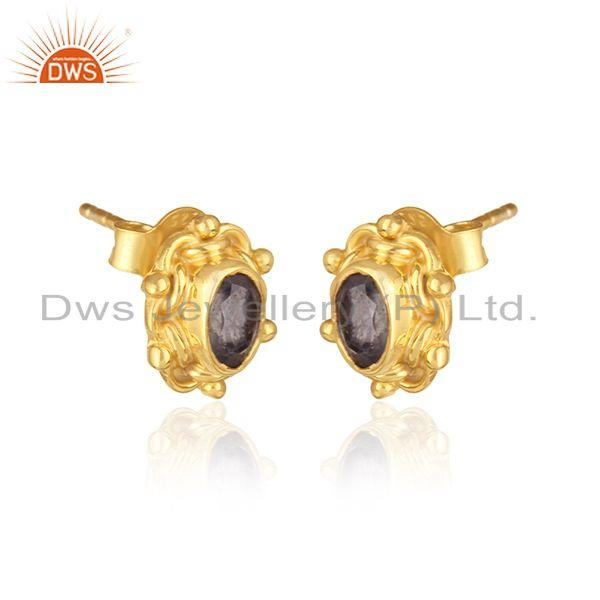 Handcrafted dainty earring in yellow gold on silver with iolite
