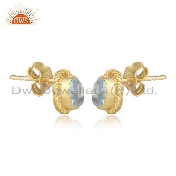 Handmade silver 925 earring with blue topaz and yellow gold on