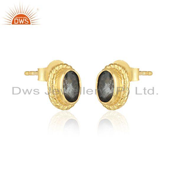 Handmade silver earring with london blue topaz and yellow gold on