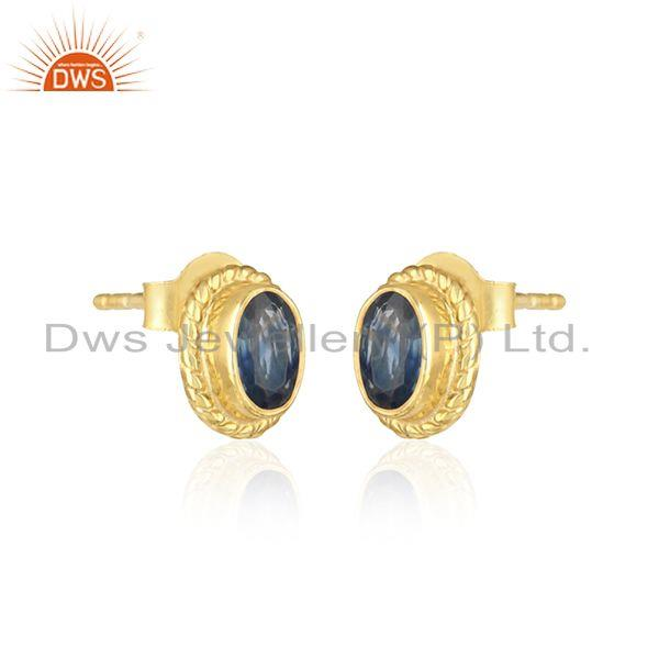 Textured silver stud with blue sapphire and yellow gold plating