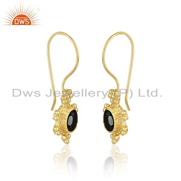 Designer dangle earring in yellow gold on silver with hametite