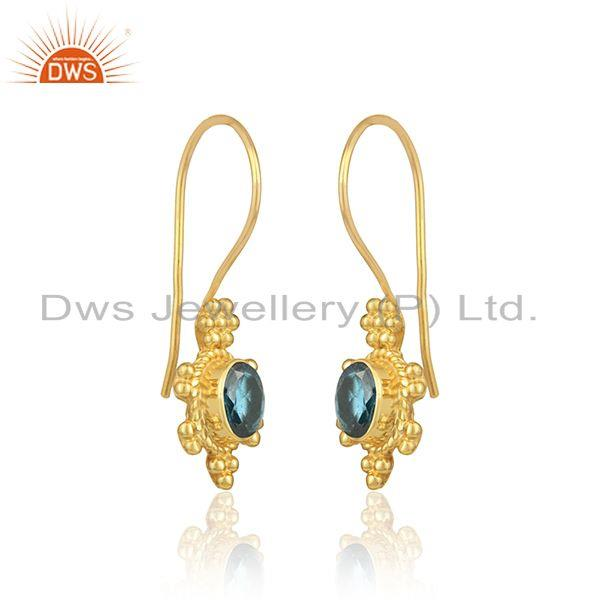 Textured earring in yellow gold on silver with london blue topaz