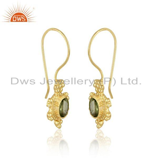 Handcrafted dangle earring in yellow gold on silver with peridot