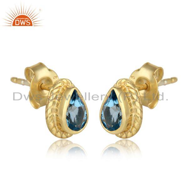 Textured stud in yellow gold on silver 925 with blue topaz