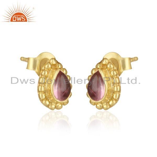 Textured silver earring with yellow gold on and pink tourmaline