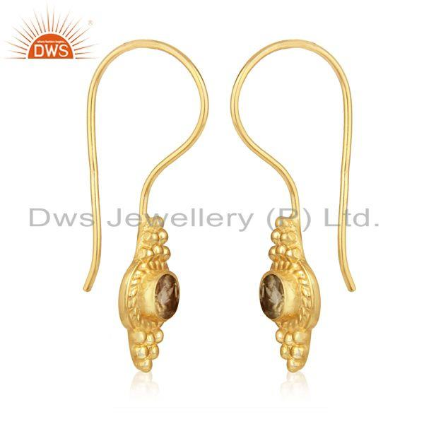 Textured earring in yellow gold on silver with natural citrine