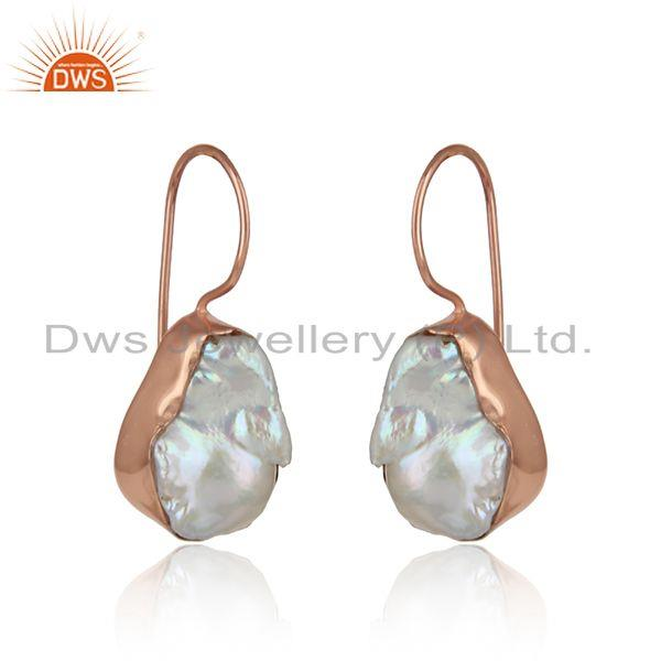Handmade earring in rose gold on silver with organic shape pearl