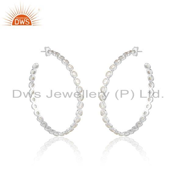 Large hoop earring crafted in solid silver with shimmering cz