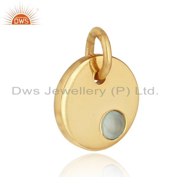 Dainty charm pendant in yellow gold on silver with aqua chalcedony