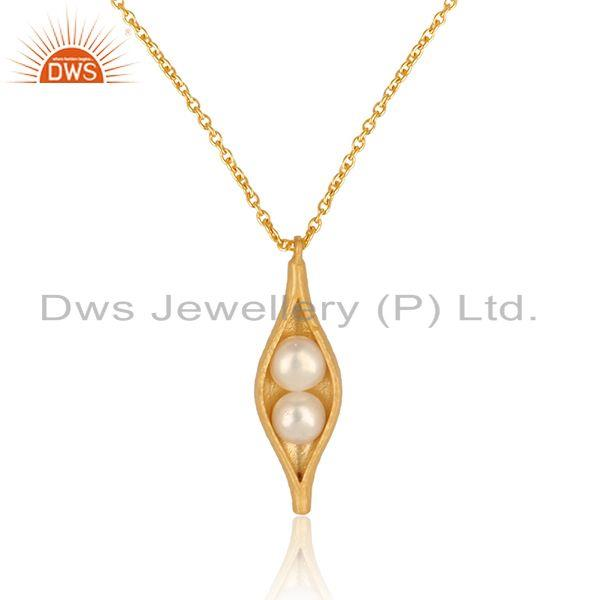 Dainty seedpod pearl pendant necklace in yellow gold on silver