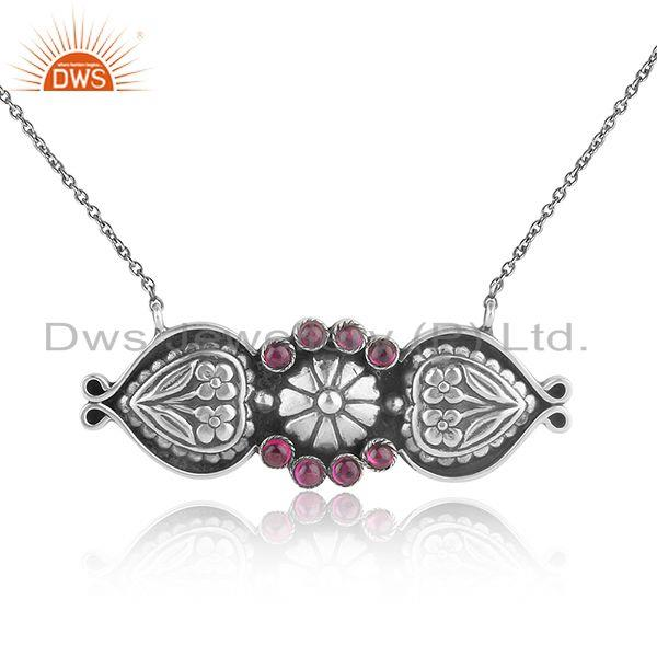 Tribal design traditional necklace in oxidized silver and red stone