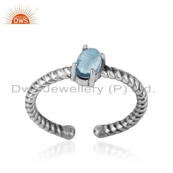 Dainty oxidized silver ring adorn with tilted natural blue topaz