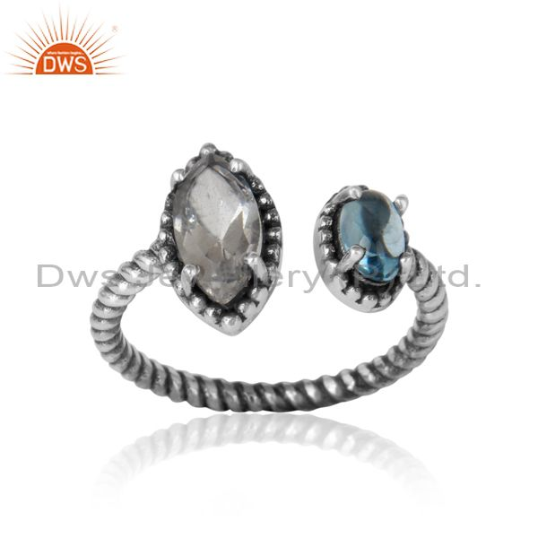 Twisted designer oxidized ring in silver blue topaz and crystal