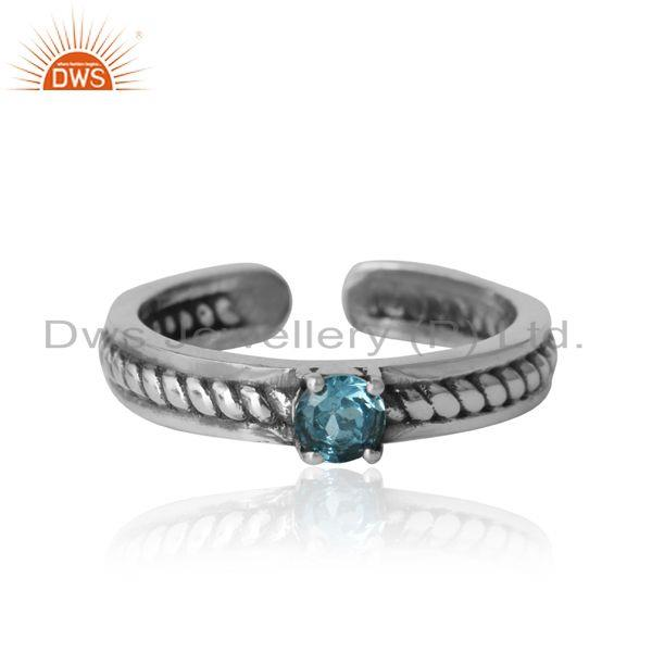 Designer twisted ring in oxidized silver 925 and blue topaz