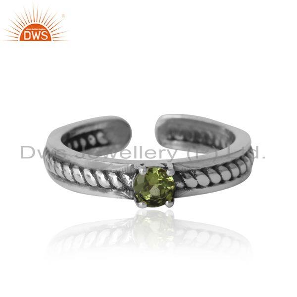 Designer twisted ring in oxidized silver 925 and peridot