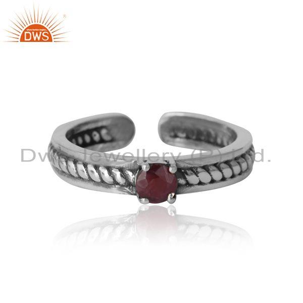 Designer twisted ring in oxidized silver 925 and ruby
